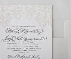 Romantic floral motifs lend an air of regal luxury to this letterpress invitation, which would make an excellent first introduction to any timeless and formal wedding.