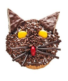 This chocolate-sprinkle-coated feline boasts York Peppermint Pattie ears, yellow M eyes, and licorice whiskers.