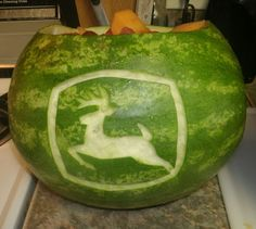 A watermelon carved with the John Deere logo is a great way to serve fruit at a kids birthday party. See more John Deere birthday party ideas at www.one-stop-party-ideas.com