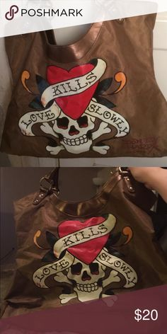 """DON ED HARDY SKULL CROSS BONES """"LOVE KILLS SLOWLY"""" Very gently used Don Ed Hardy skull and crossbones """"LOVE KILLS SLOWLY"""" purse/tote. Satin material with no signs of wear! Ed Hardy Bags Totes"""