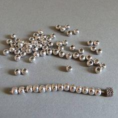 Spacer Perlen versilbert 4 mm- 1 VE