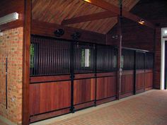 Monterey horse stall by Innovative Equine Systems have high fronts and wings for extra security.