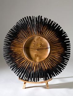 Oak platter with carved and scorched fingers by Kieran Higgins.