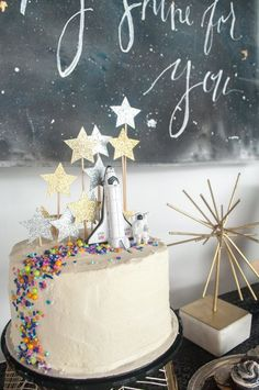 Love You to the Moon and Back monochrome space party hosted by An out of this world party with a modern chic vibe. Rocket cake with star glitter topper and Dainty Sprinkle Co Chasing Rainbows mix cake decorating recipes kuchen kindergeburtstag cakes ideas Bolo Original, Rocket Cake, Rocket Ship Cakes, Rocket Ship Party, Bolo Cake, Star Cakes, Partys, Host A Party, Party Party