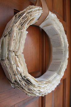 "Upcycled Book Page Wreath. , via Etsy. I love book page crafts! I've made a few book page ""trees"" and they look amazing!"