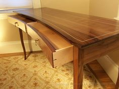 Rob's crescent front writing desk in walnut.