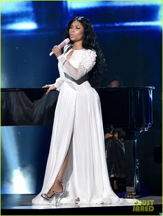 nicki minaj american music awards 2014 01 Nicki Minaj looks stunning in a white dress while taking the stage for a performance at the 2014 American Music Awards held at the Nokia Theatre L.A. Live on Sunday…