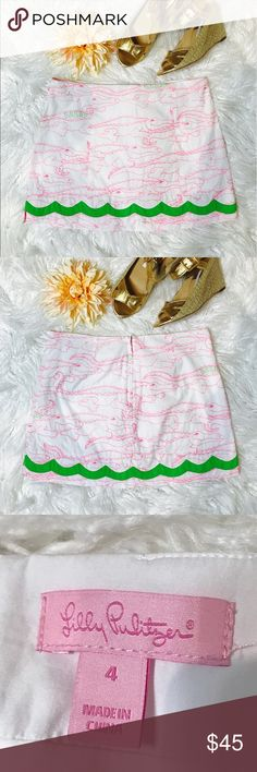 """Lilly Pulitzer Alligator Embroidered Skirt Lilly Pulitzer Alligator Growl embroidered skirt, shorts, Color: pink, white, & green.   It has pink alligators embroidered and some have Lilly spelled out on their backs. It is such a cute skort and one of my favorite patterns. Laid flat across @ waist: 15.5"""", length: 14"""". NWOT Lilly Pulitzer Shorts Skorts"""