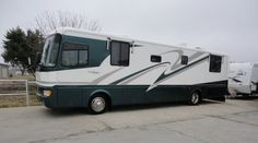 Pristine 1998 40ft Diesel Motor Coach By Monaco Ready To Hit The Open Road! Style class and elegance are the hallmark of Monaco coaches and this one is a prime example! With sleeping for up to four the whole family can get in on the fun and adventure! A well designed and very spacious full kitchen is ideal for your meal prep and is sure to save your money on the road. See more at BudgetRVsOfTexas.com