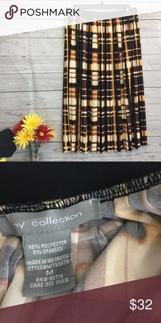 """NY COLLECTION medium skirt pleats brown multi NWOT ny collection size medium skirt. Pleats. Black waist band stretches. Multi-color, brown, yellow, etc. 95% Polyester 5% Spandex Waist 15"""" side to side can stretch to 20"""" Length 29"""" waist to hem. Measurements are approximate. Very flowy NY Collection Skirts"""