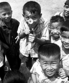 Jim Clare ©Stars and Stripes South Vietnam, July, 1969: Kids everywhere love to mug for the camera, and these youngsters in a town on South Vietnam's Mekong Delta are no exception.