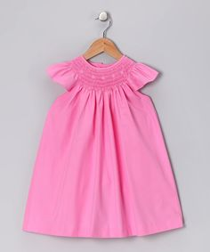 Because little girls deserve only the best, this dress is made with quality cotton and buttons down the back that create a comfortable fit. Designed with a tender love for details, it has a smocked neckline and delicate embroidery that turn special occasions into cherished memories.100% cottonHand wash; hang dryMade in Vietnam