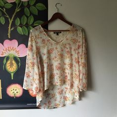 Nordstrom Rack Sheer Floral Blouse with Lace Back Lovely vintage inspired rose print on textured sheer material with lace yoke.  A little cropped in the front.  Purchased at Nordstrom Rack.  Only worn once.  Wear loose or tuck into a high waisted skirt.  Looks great with high waisted skinnies and ankle books for autumn. Happening in the Present Tops Blouses