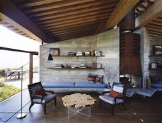 Big Sur Home by Mickey Meunnig...floating roof and that fireplace!