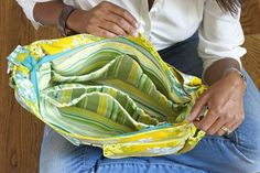 This feature-rich bag will give mums a helping hand on family outings. Free tutorial with pictures on how to make a bag in under 180 minutes by sewing with zipper, cotton, and velcro. Inspired by babies. How To posted by FW Media. Diaper Changing Pad, Changing Mat, Family Outing, Helping Hands, Bag Making, Diaper Bag, Lisa, Bags Sewing, Baby