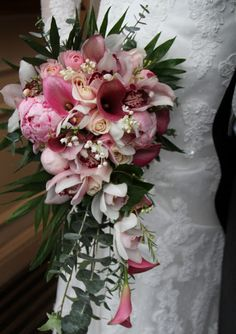 Pink Zantedeschas, Lily of the Valley,  Sweet Avalanche Roses, Pale Pink Antipodean Peonies, Ranunculas, Cymbidium Orchids and a collection of fragrant foliages