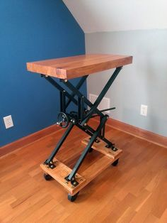 I built an industrial style scissor lift end table with a lot of brass bolts is part of Homemade tools - Post with 61 votes and 93128 views Tagged with ; Shared by BreeBree I built an industrial style scissor lift end table with a lot of brass bolts Table Élévatrice, Lift Table, End Tables, Industrial Furniture, Industrial Style, Diy Furniture, Furniture Design, Industrial Workbench, Industrial Bedroom