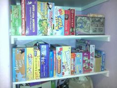 Organized kids games/puzzles in daughters room.  Placed rubber bands around the boxes to keep them from opening up. Having them upright makes for easy access. I also placed small games and puzzles in wired basket.