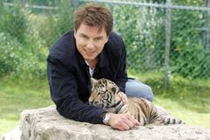 John Barrowman with a baby tiger.  Your argument is invalid!