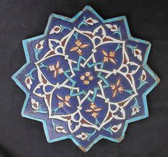 Twelve-Pointed Star-Shaped Tile Object Name: Star-shaped tile Date: A. polychrome glaze within black wax resist outlines (cuerda seca technique) Tile Art, Mosaic Tiles, Mandala, Antique Tiles, Iranian Art, Gold Work, Global Art, 14th Century, Star Shape
