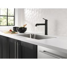 Delta Trinsic Matte Black Deck Mount Pull-Out Handle/Lever Residential Kitchen Faucet at Lowe's. Delta® faucets with DIAMOND™ Seal Technology perform like new for life with a patented design which reduces leak points, is less hassle to Pull Out Faucet, Pull Out Kitchen Faucet, Kitchen Handles, Drawer Handles, Bar Faucets, Delta Faucets, Delta Trinsic, Outdoor Sinks, Braided Hose