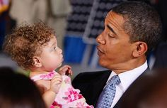 Baby Conservative resists Obama's charms and refuses to become one of his Little Liberals followers!