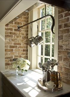 Deep windowsill, hanging rail and exposed brick work work well, simple but effective
