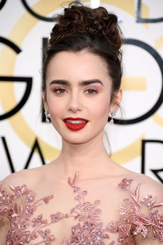 The Best Beauty Looks from the 2017 Golden Globes Lily Collins' looked amazing. Proving that pink and red can be a winning combination, Collins paired her braided, princess-like updo created by hairstylist Gregory Russell with a red lip.