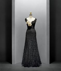 """House of Chanel (French, founded 1913), Gabrielle """"Coco"""" Chanel (French, 1883–971). Evening Dress, 1937–38, Haute Couture. Hand–sewn, machine–made black silk–rayon lace, hand–shaped with wire and horsehair at sleeves; hand–attached, machine–sewn black rayon crepe liner; white linen floral corsage with die–cut, hand–embossed, and hand–assembled flowers. Photo © Nicholas Alan Cope. #ManusxMachina #CostumeInstitute"""