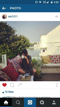 Happy guest at Rosie's Retreat Homestay, Udaipur enjoying a sunrise cuppa on the private roof terrace.