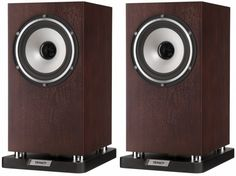 The Tannoy Revolution XT 6 Speakers is a mid-size stand or bookshelf mounted loudspeaker that represents a 'purist' Tannoy configuration, Dark walnut.