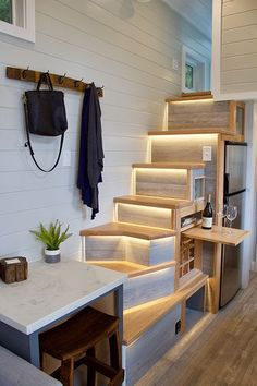 A lighted staircase leads up to the master bedroom loft.  Under the stairs is a custom-built wine rack.