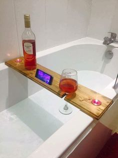Bathtub board- wine glass, phone, and candle holder.