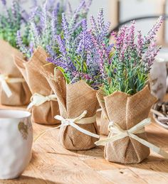 Brighten any room with this set of 2 Faux Lavender Bunches in in Burlap Pots. Tucked inside rustic burlap pots, lavender blooms are so lifelike, you'll swear you smell the sweet scent of lavender when you pass them! Wedding Centerpieces, Wedding Table, Potted Plant Centerpieces, Lavender Centerpieces, Potted Lavender, Deco Floral, Easy Home Decor, Faux Flowers, Flower Pots