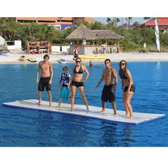 The Inflatable Walk On Water Mat - Hammacher Schlemmer. Holds up to 6 adults and enables sprinting, cartwheels, cannon balls, lounging, and even slip and sliding right into the water!