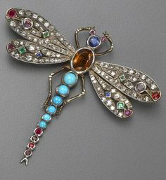 A diamond, gem-set and silver topped gold brooch