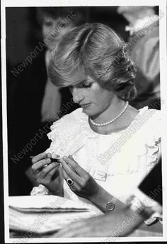 1983 Diana Princess of Wales looks at a pen from Royal Wales Press Tour