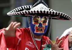 Wild fans of London 2012 - A Mexico fan cheers prior to the men's group B soccer match between Mexico and Gabon at the London 2012 Summer Olympics, in Coventry, England, Sunday, July 29, 2012. (AP)