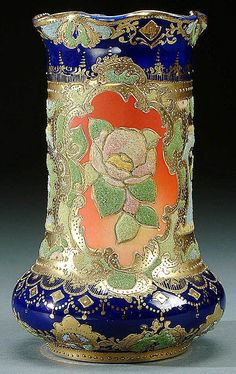 A NIPPON CORALENE DECORATED VASE CIRCA 1909 WITH BEADED GLASS DECORATION OF ROSES AND SCROLLS ON AN AMBER GROUND WITH COBALT PANELS