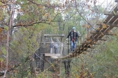 The experience involves 14 zip lines - over a mile total - from relatively close to the ground to over 175 feet in the air.