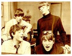The Beatles - wonder what they were working on.  They were probably not working on a song when this was taken, they were probably singing something goofy or off the cuff.