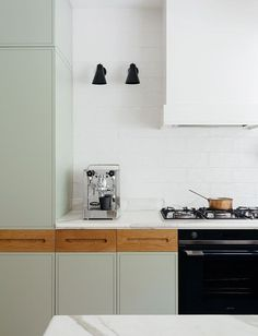 Not sure about contrasting uppers and base cabinets?  Try using drawers in a different finish for a unique look