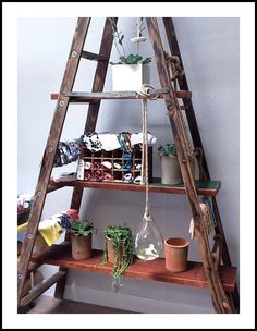 Lovely ladder shelving unit - I've seen this done in shops and it looks lovely