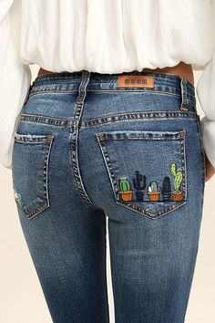 If a great pair of jeans give you heart eyes, look no further than the Cacti On You Medium Wash Embroidered Skinny Jeans! Medium-weight denim (with light whiskering and distressing) is formed to a five pocket cut, with belt loops, top button closure, and hidden zip fly. A row of embroidered cacti trim the back patch pocket atop skinny pant legs. Logo patch at back.