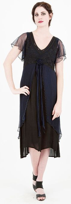 I love this dress - the shape, the dotted swiss sleeves, the subtle edges - the only thing I'm not sure I care for is the color combination - I'd like to see it in pewter over black, or black over olive. Just sayin'... #wardrobeshop