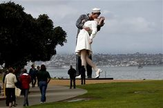 The statue entitled Unconditional Surrender stands tall in the parkway along the waterfront Monday, Feb. 13, 2012 in San Diego. The statue, which was modeled after a photograph by Alfred Eisenstaedt taken in Times Square on V-J Day at the end of World War II, is schedule to be moved at the end of the month. (AP Photo/Lenny Ignelzi)