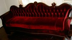 Deep velvet Red Sofa. FAB for a library, Billiard Room, a Woman's hideaway . . .