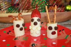 Santa Bananas & Reindeer! I was in charge of snack activity for my son's Kindergarten class. We created these mostly healthy treats with the bananas, pretzels & strawberry with chocolate chips & crainraisins for the faces. The kids enjoyed it!