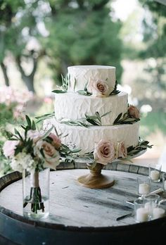 Brides: Classic Wedding Cake with Roses and Eucalyptus Leaves. A classic floral wedding cake made rustic with decorative eucalyptus leaves by Edelweiss Bakery.