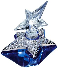 Angel Perfume by Thierry Mugler in a beautiful sparkly bottle.  I LOVE it and spray my bed sheets with it! <3